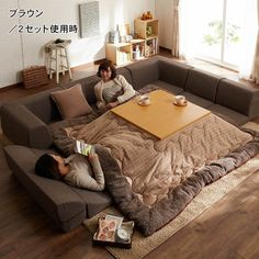 The Kotatsu. Heated from underneath, Japanese cultures use these table/blanket combinations for dining and socializing. Add an adjustable couch and you'll never want to leave. I WILL have one of these at my next house!