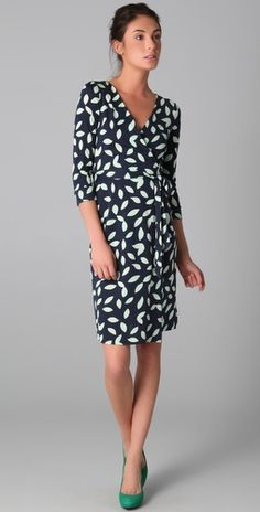 Can't go wrong with a DVF wrap dress. Classic. Pop of green shoe pulls it all together.