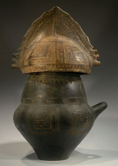Villanovan pottery urn with lid in the form of a crested helmet