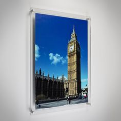 Wall-mounted clear acrylic frames perfect for photos, posters or prints with silver finish mounts. Simply sandwich your image in between the two clear acrylic panels and secure with the silver finish wall mounts supplied, making it easy to change your image.