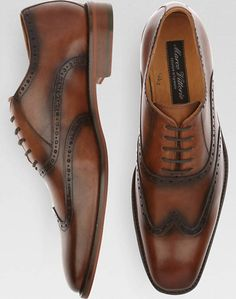These classic brown wingtip shoes feature a fine Italian leather upper and lace-up closure.