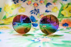 Early 90s deadstock gold metal oversized round sunglasses. Rainbow gradient revo mirror lenses. Super hippie chic sunglasses! Perfect John Lennon