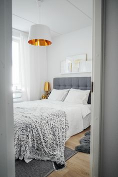 Finnish Aino Rossi makes her bed with Beach House jersey bedding in Plain White.