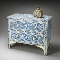 Blue dab painting to make it look like mosaic in a two-drawer dresser