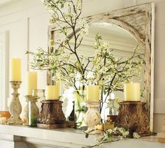 mantle decor - I like the mirror, it's both squared (frame) and rounded (mirror)