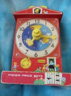 Fisher Price vintage learn to tell time clock toy 1960s. $19.00, via Etsy.