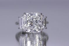 Beautiful Cushion cut diamond with Traps on the side.