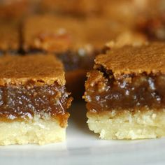 Butter Tart Squares Ingredients  CRUST½cup margarine1cup flour2Tbsp brown sugarFILLING3eggs, beaten1½cup brown sugar¼tsp salt½tsp baking powder½cup oatmeal1tsp vanilla½cup raison½walnuts  Directions  CRUSTCombine in 9×13 pan. Bake at 350 for 15 minutesFILLINGCombine and put over crust. Bake again for 20 minutes
