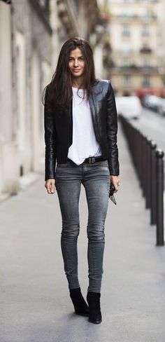 This combo of a black leather jacket and grey slim jeans is a safe bet for an effortlessly cool look. A pair of black suede wedge ankle boots will seamlessly integrate within a variety of outfits. Shop this look on Lookastic: https://lookastic.com/women/looks/jacket-crew-neck-t-shirt-skinny-jeans/16853 — White Crew-neck T-shirt — Black Leather Jacket — Black Leather Belt — Grey Skinny Jeans — Black Suede Wedge Ankle Boots