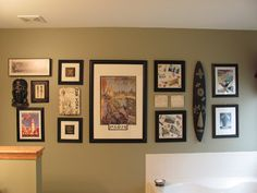 "Decorating with souvenirs: ""Smaller items can be grouped together to make a stunning display.  I used old postcards, bookmarks, and a few inexpensive prints from various places to put  together a display"""