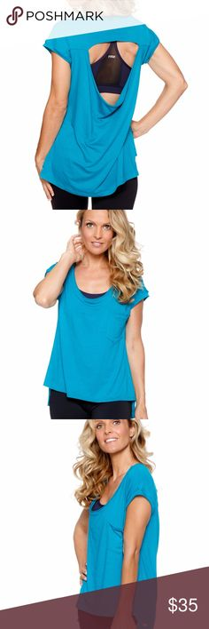 Courtney top in Jade Courtney is a new lifestyle tee with a beautiful feminine drapey open back detail. This is a great top to wear to class and then out for the day. We love this top so much we have made it in two fabrics. Our signature rayon blend fabric and a new fabulous lightweight cotton slub in anthracite and navy. This is one you will want to buy in both fabrics and all colors! Item is a sample guaranteed new and unworn but may or may not have original packaging or tags. Rese…