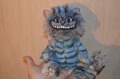 This is a Cheshire cat doll I created for my Daughter fro her birthday. I hands sculpted the head and paws with polymer clay and the body is plush with plush fur covering the head sculpt as well. Cat Doll, Cheshire Cat, More Pictures, Sculpting, To My Daughter, Polymer Clay, Plush, Hands, Fur