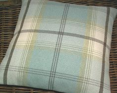 Cushion cover in a beautiful country check / tartan in mellow shades of duck egg blue, eau -de -nil, pale green and cream with a smidgen of brown.. A soft, wool / cotton mix fabric, so cosy, so stylish ..... and bang on trend! I have used the same fabric for both sides of this cover, with two wooden buttons at closure. Pattern placement may vary, but will be evenly and aesthetically placed. If purchasing two covers, pattern placement will be the same on each. Made for an 18 x 18 ...