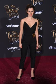 """Emma Watson wore a strapless, plunging Oscar de la Renta jumpsuit to the Los Angeles premiere of """"Beauty and the Beast""""."""