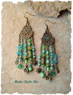 These fun Boho gypsy assemblage earrings are created with a variety of blue and green glass beads, tiny glass flowers, glass rings, frosted glass and Picasso finish beads. Antique brass is used throughout, including detailed Bohemian components, lovely bead caps, chain, and nature theme charms. Each strand has its own exclusive set of hand assembled treasures. Combined, these strands create unique boho earrings that you will adore. Length – Almost 4 inches from tops of ear wires.  Your…
