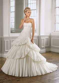 Mori Lee Style 1607  Taffeta with Appliqued floral embroidery. Removable accent flowers.