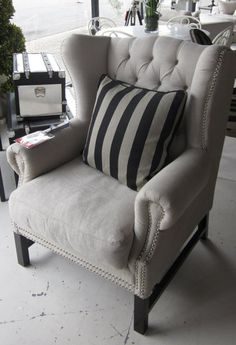 Love the look of this. Matching grey-striped with black pillow for my grey wingback... Maybe this color scheme with rich woods for family room? Ehh apothecary!!