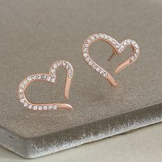Rose gold or platinum heart earrings set with pave crystals to sparkle. Unique and contemporary jewellery suitable for both everyday and evening wear. Chain Earrings, Heart Earrings, Jewellery Earrings, Valentines Presents, Presents For Her, Stylish Jewelry, Contemporary Jewellery, Personalized Jewelry, Crystal Rhinestone