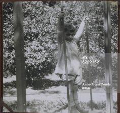 1929, Aachen, Margot standing on a swing