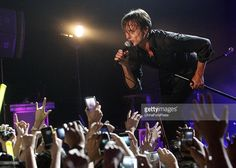 Lead vocalist Brett Anderson of the band Suede performs on stage during their concert at the Shanghai Grand Stage on August 9, 2011 in Shanghai, China.