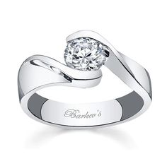 Solitaire Engagement Ring - 2313LW - Bold contemporary styling makes a strong statement of confidence for the person who wears this diamond engagement ring. A take on the vintage bypass ring of day gone by, this modern version has a channel set round diamond center and a stepped shank artfully curving down the shoulders with a bright mirror like polish for an added touch of glam. Also available in yellow, 18k and Platinum.