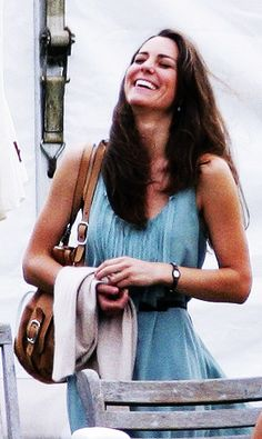 June 10, 2010, Kate Middleton watching Prince William and Prince Harry play in a polo match in Tetbury. Kate is wearing a mint green dress by Joseph.