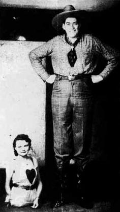 Al and Jeanie Tomani were billed as   'The World's Strangest Couple'.  Al was a giant whose height is variably listed, but he was certainly over 7' tall.  Jeanie was born without legs and with twisted arms and was 2 feet tall.  They met at a sideshow and were married when Al was 24 and Jeanie was 19.  They adopted two children and retired to Florida to run a lodge and fishing camp.  Al died of complications from his gigantism at age 50.  Jeanie lived to age 83.
