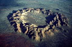 Impact Crater  Gosses Bluff, near Alice Springs, Australia was formed by the impact of a meteor or comet about 143 million years ago. It is one of the approximately 170 terrestrial impact craters on the Earth's surface.