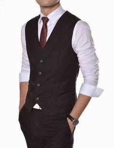 Colete preto: o clássico que sempre cai bem, principalmente com uma gravata slim.