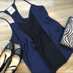 Navy and black lace tank top This adorable navy and black lace tank top is perfect for a night out! Tight around the chest then flares out. Only worn a couple of times! Great condition. Kirra Tops Tank Tops