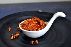 Varhadi Bhurka is a super crunchy condiment , that can give a regular meal , instant texture and a spicy kick . The peanuts , sesame seeds and coconut , spiced with red chili powder, makes it a trademark Varhadi dish .