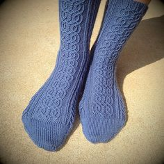 This sock inspired by a character in The Wheel of Time book series: Siuan Sanche, Aes Sedai of the Blue Ajah, was born in Tear, and grew up a fisherwoman. She was the Amyrlin (head of all Aes Sedai), and has a talent of being able to see Ta'veren. Wheel Of Time Books, Knitting Socks, Knit Socks, A Hook, Book Series, Ravelry, Free Pattern, Knit Crochet, Fiber Art