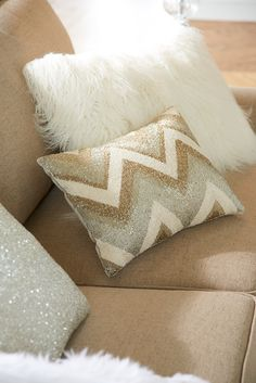 At home in modern or glam regency settings, this Beaded Zigzag Lumbar Pillow from Pier 1 is just a little indulgent. Well, maybe more than just a little. Hundreds of shimmering beads, in shades of Tahitian pearls, have been individually hand-sewn on a poly satin cover for a rich, unique look. Finished and ready for your home, a shaped insert is tucked inside a concealed zipper closure.