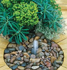 A stone floor fountain incorporates moving water into the landscape in understated ways. Myhomeideas.com
