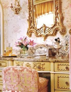 """ A decidedly feminine dressing table. The wallpaper and pink chenille fabric on the stool are luxurious, to say the least. And yes, Charles Faudree again! """