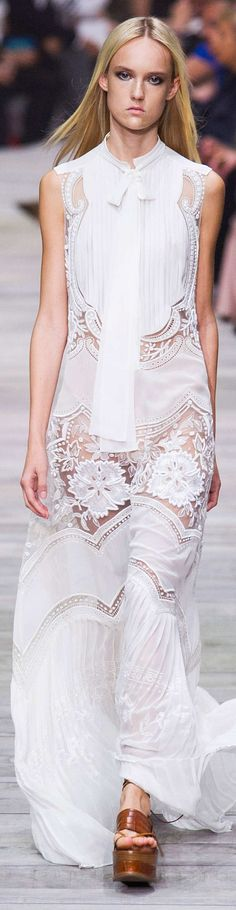 Roberto Cavalli Collection Spring 2015..too bad the model isn't having any fun wearing this beautiful lace dress