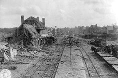 """What's left of the railway station and city of Saint-Lô, a key point in Normandy. Ninety-five percent of the city was destroyed, apparently prompting one soldier to comment, """"We sure liberated the hell out of this place."""""""