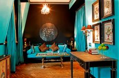 I love this aqua room with a touch of leopard