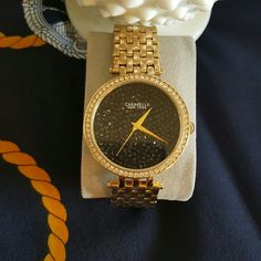 CARAVELLE by Bulova Watch One day sale price.  Gold-colored watch, black crystals. Caravelle Accessories Watches
