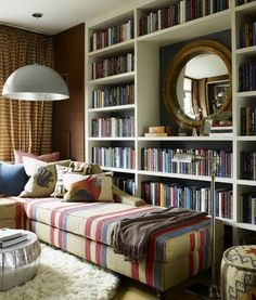 I love when books are behind a sofa.  You can just curl up and grab a book.