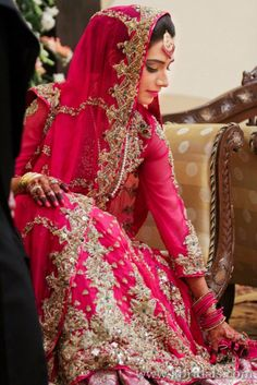 Beautiful Indian Bride in a beautiful watermelon color dress