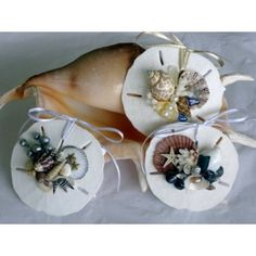 Sand Dollar Ornaments decorated with shells - pretty for decorating at the #holidays