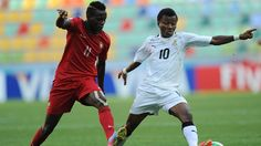 Bruma of Portugal challenges for the ball with Clifford Aboagye of Ghana