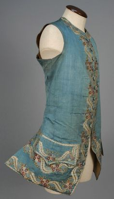 Waistcoat, France, 1760-1775. Blue patterned weave silk, delicately embroidered with a polychrome silk floral, embroidered buttons, silk and linen lining.