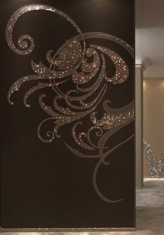 Wow. Leaf and Swarovski crystals on Silven wallcoverings.
