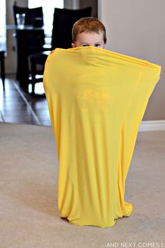Using a homemade sensory tunnel as a body sock - perfect for kids with autism and sensory processing disorder from And Next Comes L