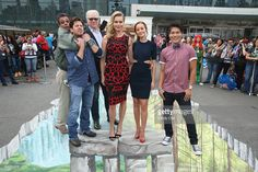 Producer Dean Devlin, actors Christian Kane, John Larroquette, Rebecca Romijn, Lindy Booth and John Kim pose at the TNT/TBS: The Librarian Season 2 3D street art activation. TNT at the New York Comic Con 2015 at the Jacob Javitz Center on October 9, 2015 in New York, United States. 25749_002 087