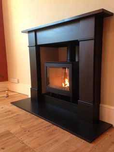 The Contura i5L Panoramic in black with a black slate fireplace fitted by Hagley Stoves