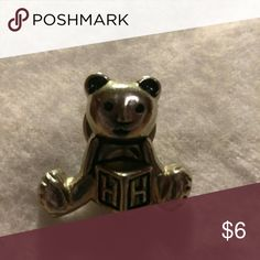 Teddy Bear Lapel Pin Silvertone metal,  aluminum alloy.  Measures about 1/2 inch in length.  Cute for your little girl or bear lovers or collectors. Jewelry Brooches