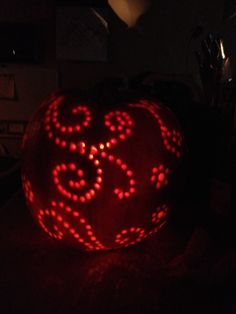Designer pumpkin free handed the pattern and traced with drilled holes. Tried this tonight. Didn't turn out like the picture. I think the trick is to use a smaller drill bit than you think you need. And leave lots of space between designs.